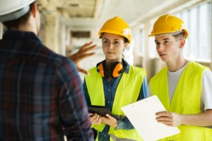 Construction workers talking at site --- Image by © Igor Emmerich/Corbis