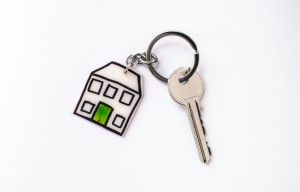 House key with home keyring arranged in a studio from above as symbol isolated on a white background with copy space.