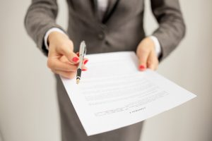 Woman offering to sign contract